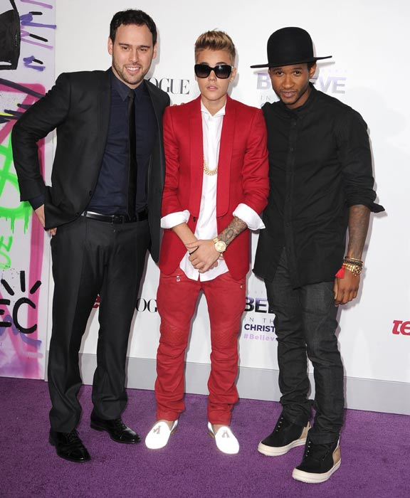 Justin with usher and scooter braun