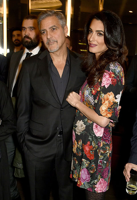 George Clooney Amal Clooney pregnant twins posing for photo