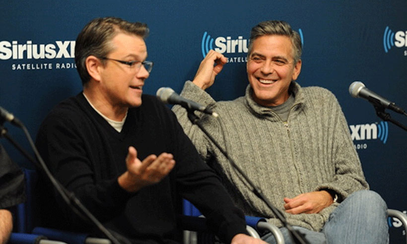 George Clooney Matt Damon chatting at conference