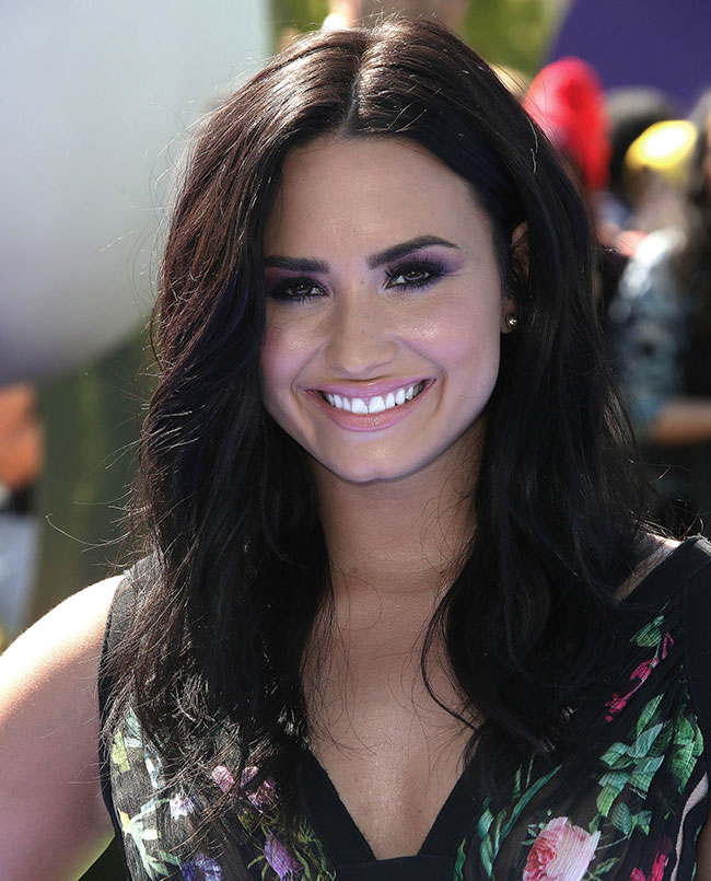 Demi's beachy waves are ideal for festivals