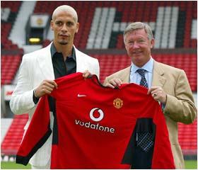 Britain's most expensive footballer Rio Ferdinand is presented at Old Trafford by Manchester United manager Alex Ferguson