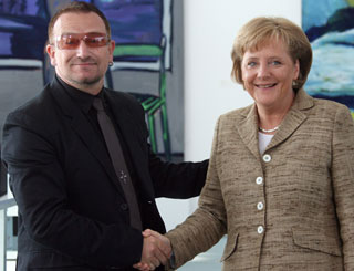 Bono talks debt with German chancellor