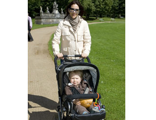 Devoted mum Mary takes her prince for a stroll