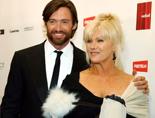 Hugh Jackman has a ball at benefit auction