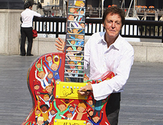 Macca adds his moniker to good-cause guitar