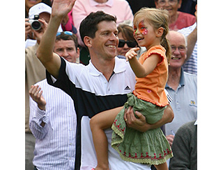 Tim Henman celebrates match victory with daughter