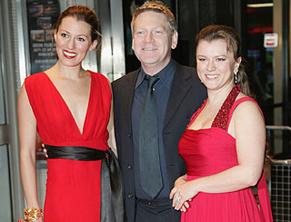 Kenneth Branagh joins ladies in red for UK premiere