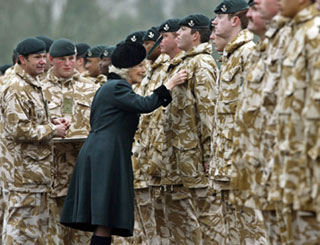 Camilla inspects returning soldiers