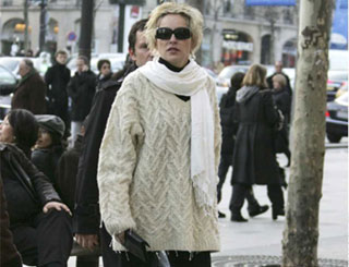 Sharon adopts winter woollies on Paris trip