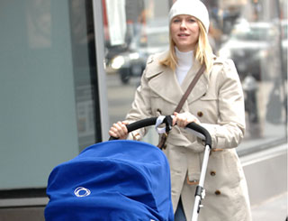 Naomi Watts takes her baby for a stroll