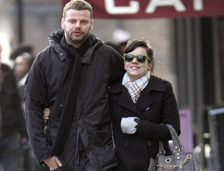 Expectant Lily Allen out and about with her man
