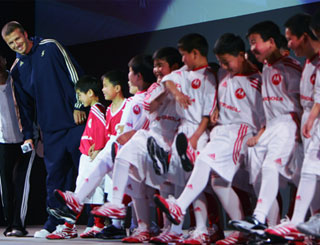 Kids 'hokey cokey' for Becks in China