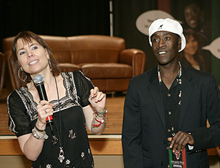 Caring Don Cheadle puts on a poker face for Africa