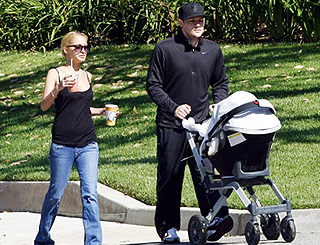 Nicole and Joel share sunny stroll with baby Harlow