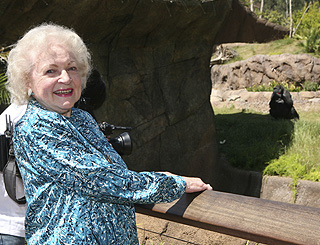 Betty White enjoys some monkey business at the zoo