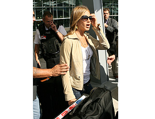 Jennifer Aniston jets in to support new music love