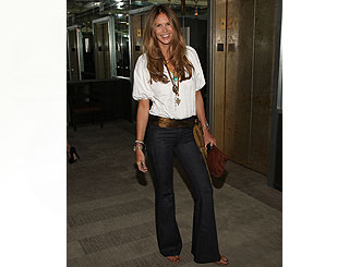 Elle Macpherson shows a flair for flares at premiere