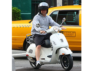Liev Schreiber hits NY on his new scooter