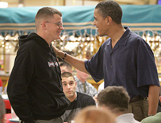 Barack Obama pays festive visit to troops in Hawaii