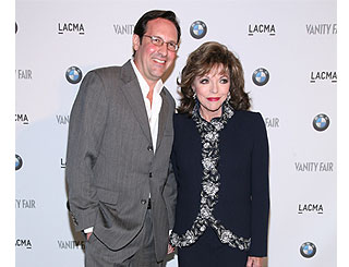 Joan Collins and husband zoom in to motor show