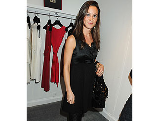 Stylish Pippa attends designer store launch