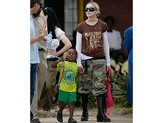 Madonna takes adopted son David to see his father