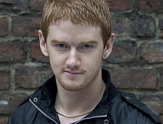 Corrie's Mikey North back at work on street after attack