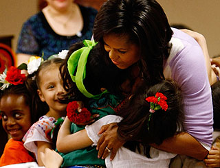 Hugs for Michelle as she marks Mexican holiday with schoolkids