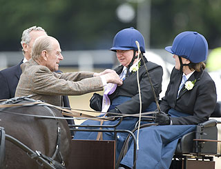 Ex-carriage-driver Philip steps in to hand out sport's prizes