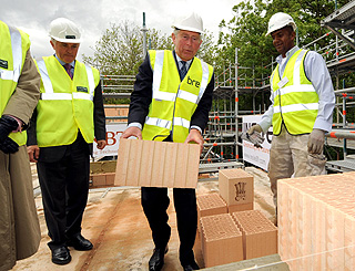 'Builder' Prince Charles puts his back into construction