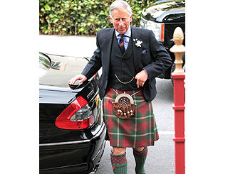 Kilt-wearing Charles visits remote Scottish islands