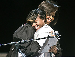 Michelle Obama offers hugs and advice to new graduates