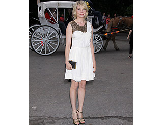 Michelle Williams works white look at charity ball in NYC