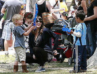 Liv Tyler and son Milo join LA locals for balloon fun in park