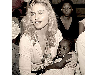 Mercy could join mum Madonna in the US this week