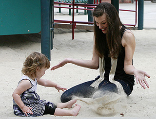 Sandy playdate for model mum Milla Jovovich and little Ever