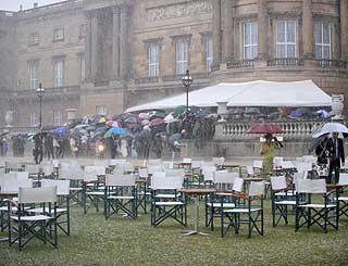 Torrential downpour washes out Queen's garden party