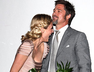 Brad Pitt has Diane Kruger in giggles on the red carpet