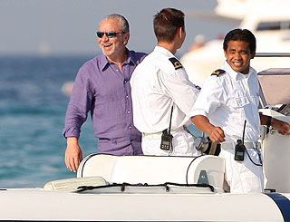 Rest and relaxation for smiling Sir Alan Sugar in Saint Tropez