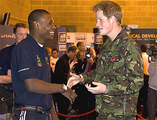 Prince Harry keeps war hero's spirits up during injury claim