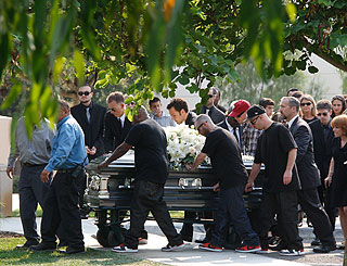 Sneaker-clad pallbearers lay DJ AM to rest