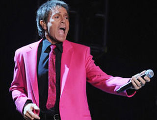 Sir Cliff slips back into his pink jacket after half a century