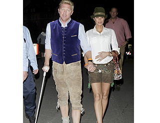 Lederhosen-clad Boris Becker overcomes hip op to attend beer fest
