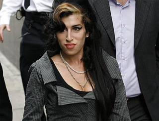Amy Winehouse flies in 'healing hands' to help battle addictions