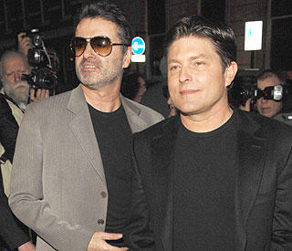 George Michael denies split from long-term love Kenny