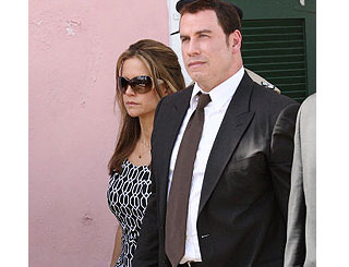 Woman accused of burning John Travolta document