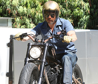 Brad Pitt bumps one of his beloved motorcycles