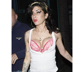 Amy Winehouse proudly shows off her new assets