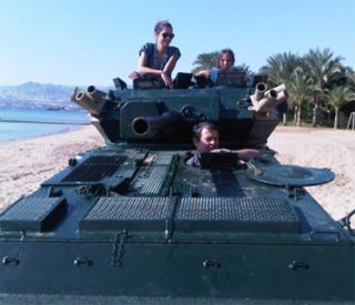 Queen Rania turns Lara Croft on husband's tank