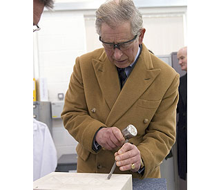 Prince Charles chips in during stone carving demo